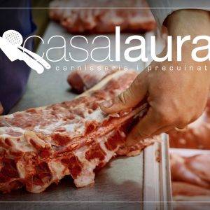 closeup of a caucasian man preparing some meat stuffed cannelloni on the countertop of a kitchen