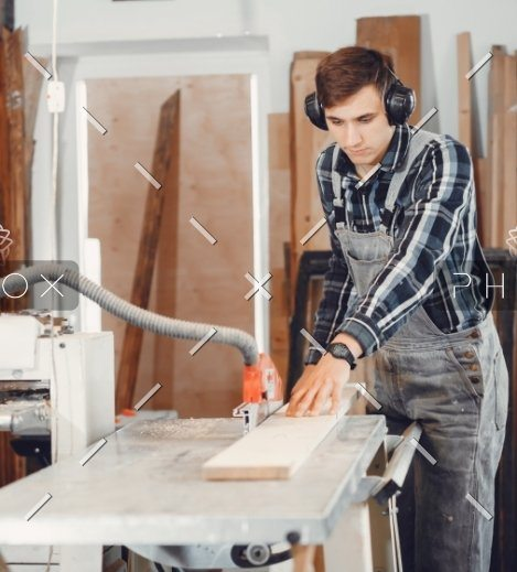 demo-attachment-110-the-carpenter-works-with-a-tree-WAFRT59